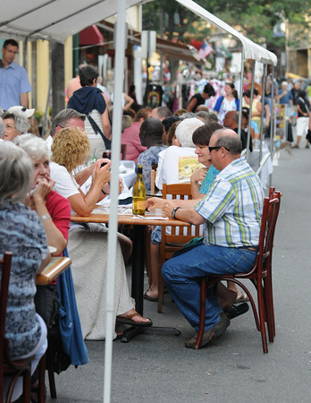 Gloucester: People enjoy some food and wine while dinning out  at the Annual Block Party on Main St Saturday night. Desi Smith/Gloucester Daily Times. July16,2011