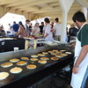 Manchester: Tyler Rossi,17 flips pancakes at the Annual Red White and Blue Breakfast in Manchester Tuck's Point Saturday morning.<br /> Proceeds benefit Rotary Club scholarships and community service projects. Desi Smith/Gloucester Daily Times. July 2,2011.