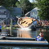 Essex: (Along for the ride) High School Intern Zack Teal 16, who helped work on the Ardelle was on board when launched into the Essex River Saturday afternoon at H.A Burnham. Desi Smith/Gloucester Daily Times. July 9,2011