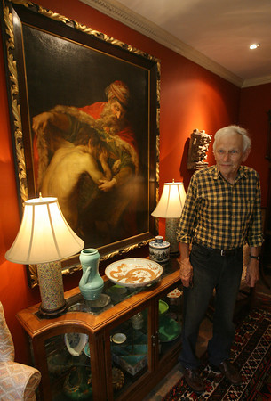 Jack Carter of the Raymond Alger gallery on Pleasant Street in Gloucester stands near one of his favorite paintings, the Prodigal Son by Pompeo Batoni. The gallery has not opened since March due to a fire, which gutted the building adjacent to the gallery. The gallery still smells of smoke and has water damage. Photo by Kate Glass/Gloucester Daily Times