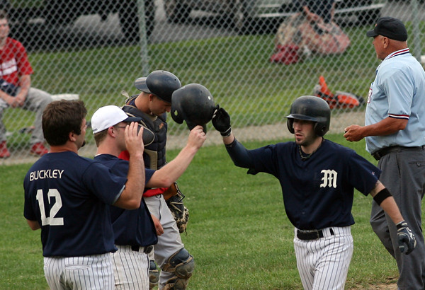 Rory Gentile's Manchester teammates greet him at home plate following his three-run home run against Rockport during their ITL game at Memorial Field last night. Photo by Kate Glass/Gloucester Daily Times<br /> , Rory Gentile's Manchester teammates greet him at home plate following his three-run home run against Rockport during their ITL game at Memorial Field last night. Photo by Kate Glass/Gloucester Daily Times
