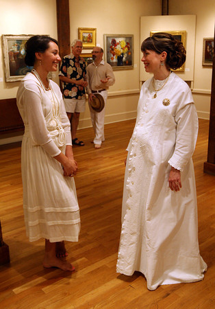 Chappell Sargent, wearing a post World War I dress, chats with Katharine Worth, wearing a maternity dress from the 1800s, during the Summer White Fashion Show at the Rockport Art Association yesterday. Photo by Kate Glass/Gloucester Daily Times