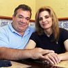 David Le/Gloucester Daily Times. Deo Braga, right, and his wife, Paula, own 7 Dunkin' Donuts, 2 gas stations, a shopping plaza and the Azorean, in the Cape Ann area. 7/11/11.
