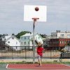 David Le/Gloucester Daily Times. Dru Ouellette, 8, of Gloucester, stands and watches as the basketball he had shot flies towards the hoop at Fort Point Park on Wednesday morning. 7/13/11.