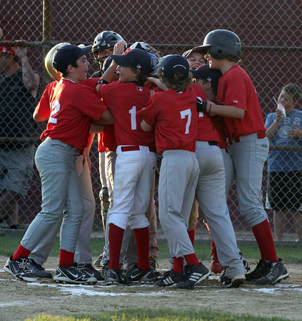 Sal Costanzo's teammates congradulate him after he hit a homerun during the first at bat of the second world series game on Wednesday night verses the Pirates. Pirates won 6-3. Photo by Maria Uminski/Gloucester Daily Times