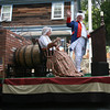 Bob Ryan of Ryan & Wood Distilleries waves to the crowd while dressed as George Washington during the Manchester 4th of July Parade. The float won for best commercial float. Photo by Kate Glass/Gloucester Daily Times