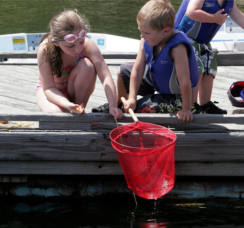 Natasha Akerley, 7 of Essex and Theo Caplan, 4 of Manchester wait for the crabs to take their bait while they try to catch them at Tucks Point. Photo by Maria Uminski/Gloucester Daily Times