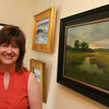 "Teri Canelle Eramo recently opened Eventide, an art studio and gallery, on Main Street in Essex. The gallery features her paintings, such as ""Evening Marsh,"" as well as the works of other local artists. Photo by Kate Glass/Gloucester Daily Times"