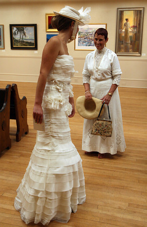 Emma Cowan, left, chats with Pamela Bynum, who helped organize the Summer Whites Fashion Show at the Rockport Art Association yesterday. The show featured vintage outfits as well as modern pieces. Photo by Kate Glass/Gloucester Daily Times