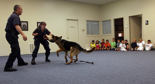 Gloucester: Sgt. Jenna Walsh and Sgt. Steve Tsoukalas of the Essex County Sheriff's Department K-9 Unit show how Dozer is trained to attack during a demonstration at Mahaney's Uechi Karate Academy yesterday afternoon. They recently competed in the United States Police K-9 Association Trials and finished second overall in the team competition. Photo by Kate Glass/Gloucester Daily Times