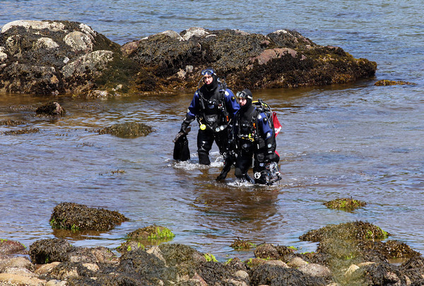 Todd and Eric Smith of Leominster, emerge from the water following a dive at Folly Cove. The two say they try to dive at the cove at least once every summer. Photo by Kate Glass/Gloucester Daily Times