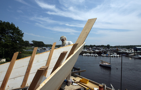 Essex: Steve Willard sands the stern of the schooner Ardelle at the Burnham Boatyard yesterday afternoon as they get ready to launch the ship on Saturday. Photo by Kate Glass/Gloucester Daily Times