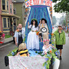 Gloucester: Love your Mother float carring Sophia Mustone 6, and Micah Galuski 7' wave to the crowd as Isac Galuski 5, and Tatum Galuski 9, enjoy the ride and the crowd in the Horribles Parade Sunday afternoon. Desi Smith/Gloucester Daily Times. July3,2011