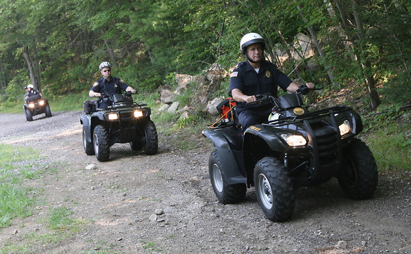"Gloucester Police Lt. Tom Williams leads members of the Cape Ann Regional Response Team into the woods off Forest Lane to search for Sergei ""Jay"" Samoylenko, who was reported missing late Monday night. His body was found at Haskell Pond Tuesday afternoon. Photo by Kate Glass/Gloucester Daily Times"