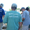 Essex:  Volunteer's  wear their shirts with the slogan Build Locally-Sail Globally at the launching of the Ardelle into the Essex River Saturday afternoon at H.A Burnham. Desi Smith/Gloucester Daily Times. July 9,2011