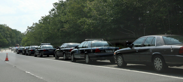 "Nearly a dozen police cars line the breakdown lane of Route 128 southbound just past exit 14 as they search the nearby woods for Sergei ""Jay"" Samoylenko of Bedford, who was reported missing late Monday night. His body was found at Haskell Pond Tuesday afternoon. Photo by Kate Glass/Gloucester Daily Times"