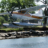 David Le/Gloucester Daily Times. A Cessna 180 water plane piloted by Keith Deschambeault, owner and pilot of Acadian Seaplanes, of Rangeley Maine, takes off from the Blynman Canal on Friday morning. 7/1/11.