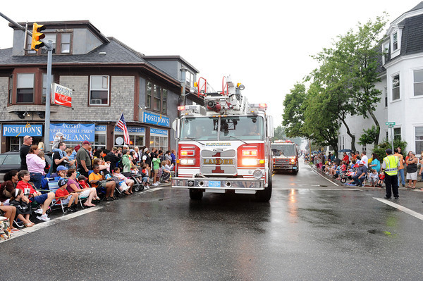 Gloucester:  Gloucester's Ladder 1 blows their horns as some people in the Horribles Parade Sunday afternoon. Desi Smith/Gloucester Daily Times. July3,2011