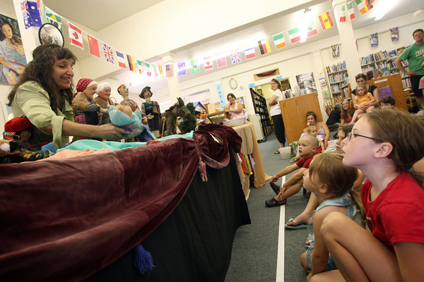 Dora Tevan of the Ethnic Arts Center performs four puppet shows from four different countries at the T.O.H.P. Burnham Library on Wednesday as part of their summer reading program. Photo by Kate Glass/Gloucester Daily Times