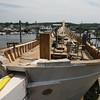 Essex: Work continues on the schooner Ardelle, which will be launched this Saturday at the Burnham Boatyard. Photo by Kate Glass/Gloucester Daily Times