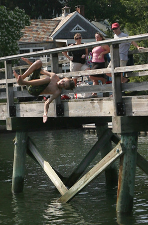 Tim Stone tries a flip off the foot bridge in Annisquam on Tuesday afternoon. Photo by Kate Glass/Gloucester Daily Times