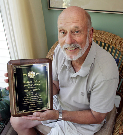 """David Le/Gloucester Daily Times. Rockport """"Citizen of the Year"""" recipient, Frank Hassler, displays the plaque awarded to him in his Rockport home on Monday afternoon. 7/11/11."""