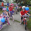 Manchester: Clara Grant 4, of Manchester, left along with other young riders,get ready to ride in the Manchester Bike Parade held Sunday afternoon at Masconomo Point. Desi Smith/Gloucester Daily Times. July 2,2011.