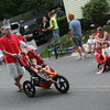 Scott DeLuca pushes his son, Anderson DeLuca with his classmates at Sandy Bay Preschool during the Rockport Firemen's Association's Parade last night. Photo by Kate Glass/Gloucester Daily Times