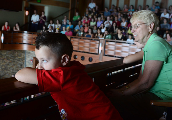 Rockport: Beckham Hughes 6, of  Rockport and his Grandmother Mildred Truhan visiting from Connecticut, watches and listens to the music by Ten Tumbao that performs Latn American music on a variety of fun instruments Saturday morning at the Shalin Liu Theater. Desi Smith/Gloucester Daily Times July 16, 2011.