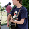 Riley Hunt of Gloucester plays some of his favorite covers for the crowd at the Cape Ann Farmer's Market on Thursday. Photo by Maria Uminski/Gloucester Daily Times