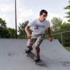 David Le/Gloucester Daily Times. Rodrigo Pardo, of Gloucester zooms down the halfpipe at Sweeney Park in Manchester on a hot July afternoon. 7/12/11.