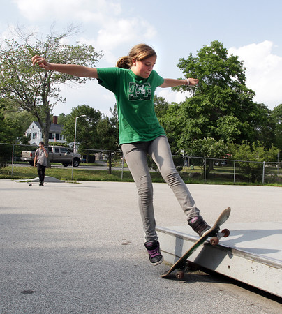 David Le/Gloucester Daily Times. Megan Welcome, 14 of Rockport, performs a trick on an obstacle in Sweeney Park on Tuesday afternoon. 7/12/11.