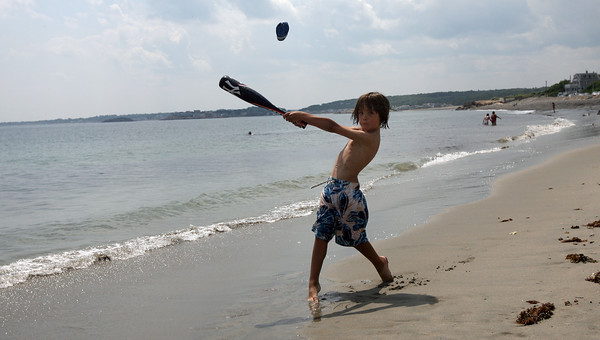 Rockport: Liam Gott, 7, of New York plays baseball on Pebble Beach while in Rockport for an annual family reunion. Photo by Kate Glass/Gloucester Daily Times