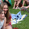 "Madelyne Dixon, 8 of Rockport and her mom, Heidi Goodwin go face to face with an alligator at the ""One World, Many Tails"" event put on by Rockport Library with the help of Critters 'N Creatures. Photo by Maria Uminski/Gloucester Daily Times"