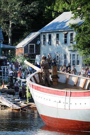 Essex:  High School Intern Zack Teal 16, waves to spectators while on the Ardelle. Teal who helped work on the Ardelle was on board when launched into the Essex River Saturday afternoon at H.A Burnham. Desi Smith/Gloucester Daily Times. July 9,2011