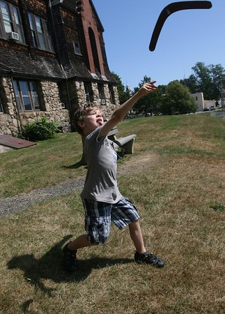 Essex: Alexander Wolf throws a boomerang during a World Fair at the TOHP Burnham Library yesterday morning. The boomerang is traditionally used in hunting and for sport in Australia. Photo by Kate Glass/Gloucester Daily Times