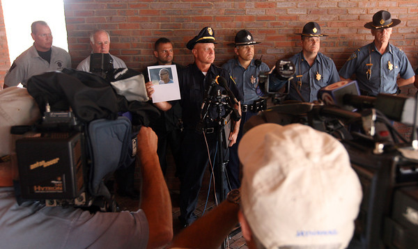 "Gloucester Police Chief Michael Lane holds up a photo of Sergei ""Jay"" Samoylenko, whose body was found at Haskell Pond Tuesday afternoon. Photo by Kate Glass/Gloucester Daily Times"