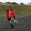 Jayden Deltorchio, 5, raises his arms in celebration as he crosses the finish line ahead of Ryan Lewis, 4, during the Little Kiddies Track Program at O'Maley Middle School. The program runs Wednesday nights at 6pm and is sponsored by the Gloucester Parks and Recreation Department and Cambridge 7 Associates. Photo by Kate Glass/Gloucester Daily Times