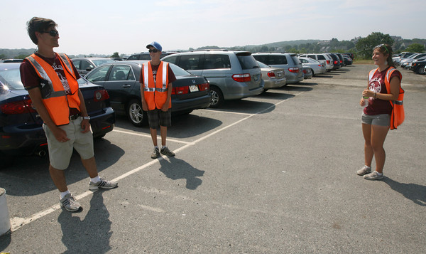 Austin Waldsmith, Nathan Lafata and Trina Lafata take a break after a long day parking cars at Good Harbor Beach yesterday. The three said the heat did not bother them and they made sure to drink a lot of water. Photo by Kate Glass/Gloucester Daily Times