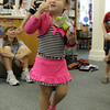 David Le/Gloucester Daily Times. Lola Victoria Gaudette, 3 of Gloucester dances around while eating a snack and listening to music played by guest musician John Root at A World of Music program held at the TOHP Burnham Library in Essex on Monday. 7/11/11.