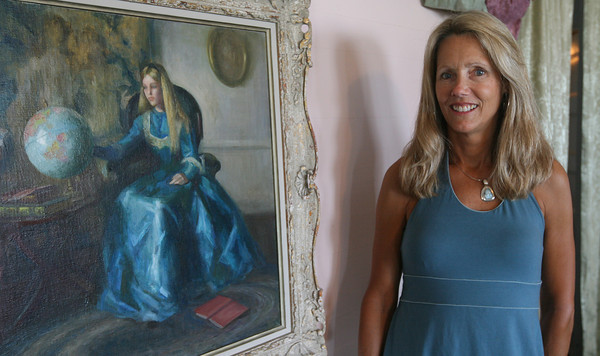 "Alison (Cameron) Callahan of Rockport stands in front of a portrait that was painted of her when she was a girl by the late Marguerite Pearson, a noted 20th century American portrait artist. The painting is titled ""The School Girl.""  Rockport Art Association opens an exhibition titled  ""Marguerite Pearson –- Hell on Wheels"" with a free public opening reception on Friday, July 22 at the RAA at 12 Main St. from  6 p.m. - 8 p.m. The show runs through Aug. 23."