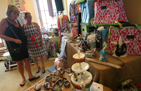 Donna Currier and Janelle Favaloro browse merchandise of sue b. do of Cape Cod during the Barefoot at Rockport Designer Pop Up Shops at the Shalin Liu Reception Hall yesterday. Photo by Kate Glass/Gloucester Daily Times