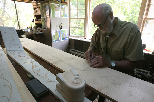 Bob Brophy of Essex carves the nameplate for the schooner Ardelle, which will be launched at Burnham's Boatyard on Saturday. Brophy has done engravings for five schooners, including the Lannon. Photo by Kate Glass/Gloucester Daily Times