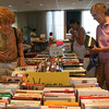 Dorothy Geiser, left, and Barbara Sparks, both of Rockport, search through the fiction section of the Friends of the Library book sale at the Rockport Library yesterday afternoon. The sale runs through Sunday and all proceeds benefit the library. Photo by Kate Glass/Gloucester Daily Times