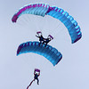 Members of the Air Adventures Parachute Team approach Coach Ed Field Field following the Manchester 4th of July Parade yesterday. Photo by Kate Glass/Gloucester Daily Times