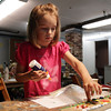 David Le/Gloucester Daily Times. Helen Ives, 7, of Brookline, firmly glues a marble to her art board at Rockport Art Association's Garden Sculpture workshop on Tuesday. 7/12/11.