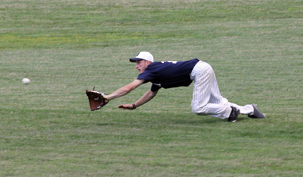 Jeremy Nicastro makes a diving catch in right field as Manchester and Rockprt play at Memorial Field last night. Photo by Kate Glass/Gloucester Daily Times