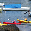 David Le/Gloucester Daily Times. A small group of kayakers paddle out of the harbor at Bearskin Neck on a warm Monday afternoon. 7/11/11.