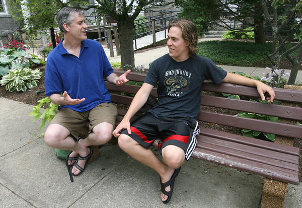 Dave Cutler, organizer of the Rockport Acoustic Music Festival, talks with musician Jake Pardee about plans for this year's festival, which will be on August 14th at Millbrook Meadow. Photo by Kate Glass/Gloucester Daily Times