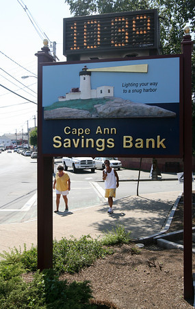 Gloucester: Pedestrians check out the temperature reading on the Cape Ann Savings Bank sign, which was 103 by mid afternoon yesterday. Photo by Kate Glass/Gloucester Daily Times